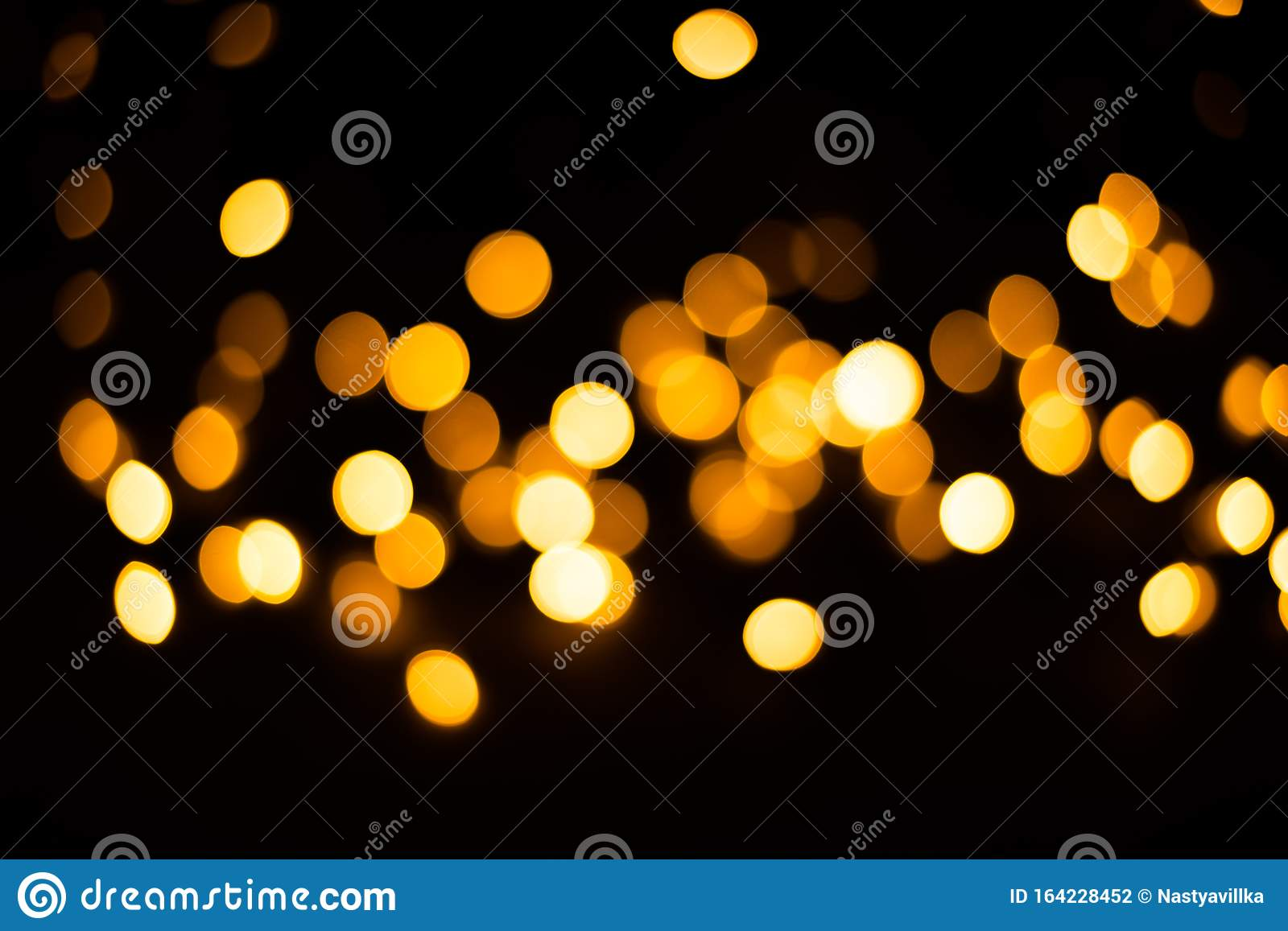 blurred background christmas lights black yellow light bulbs festive 164228452