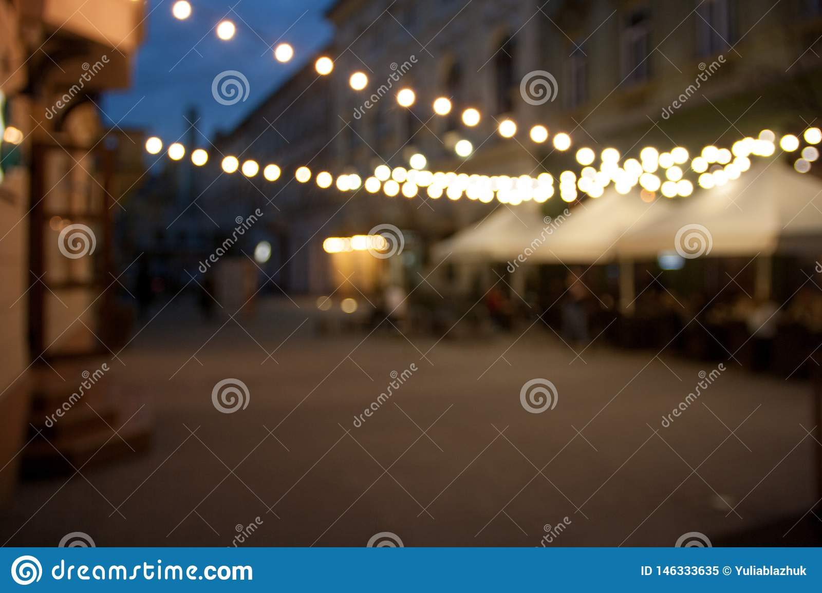 Blurred night city empty street background with bokeh