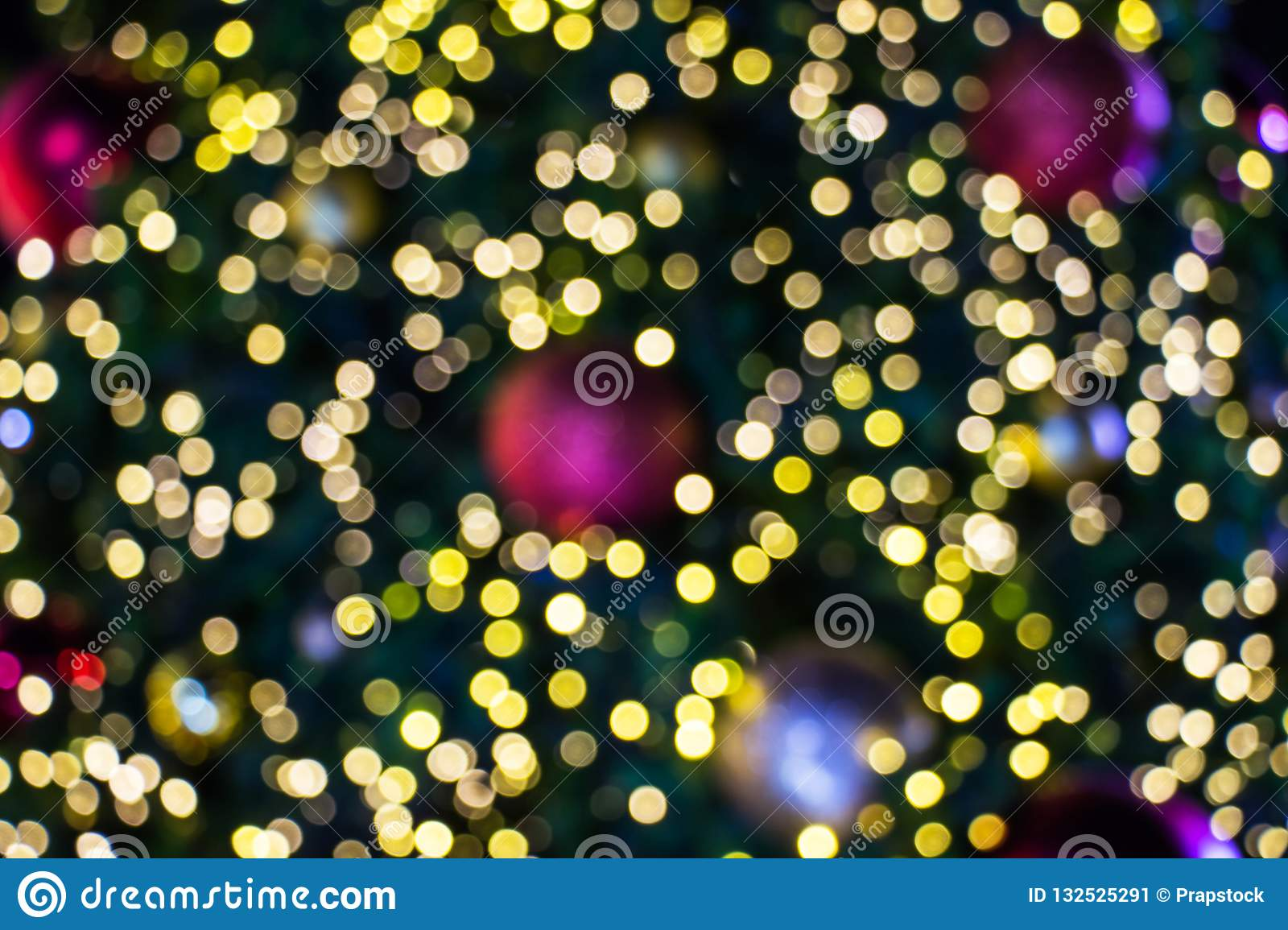 Blurred bokeh of Christmas light background. Close up decoration