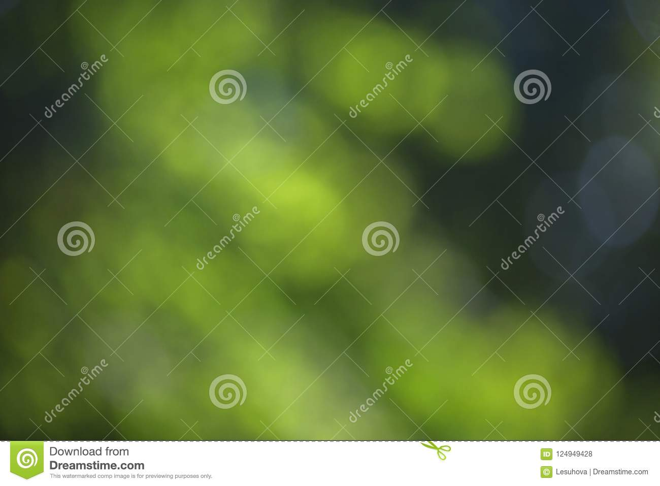 Blurred bokeh effect on a background of green tree leaves