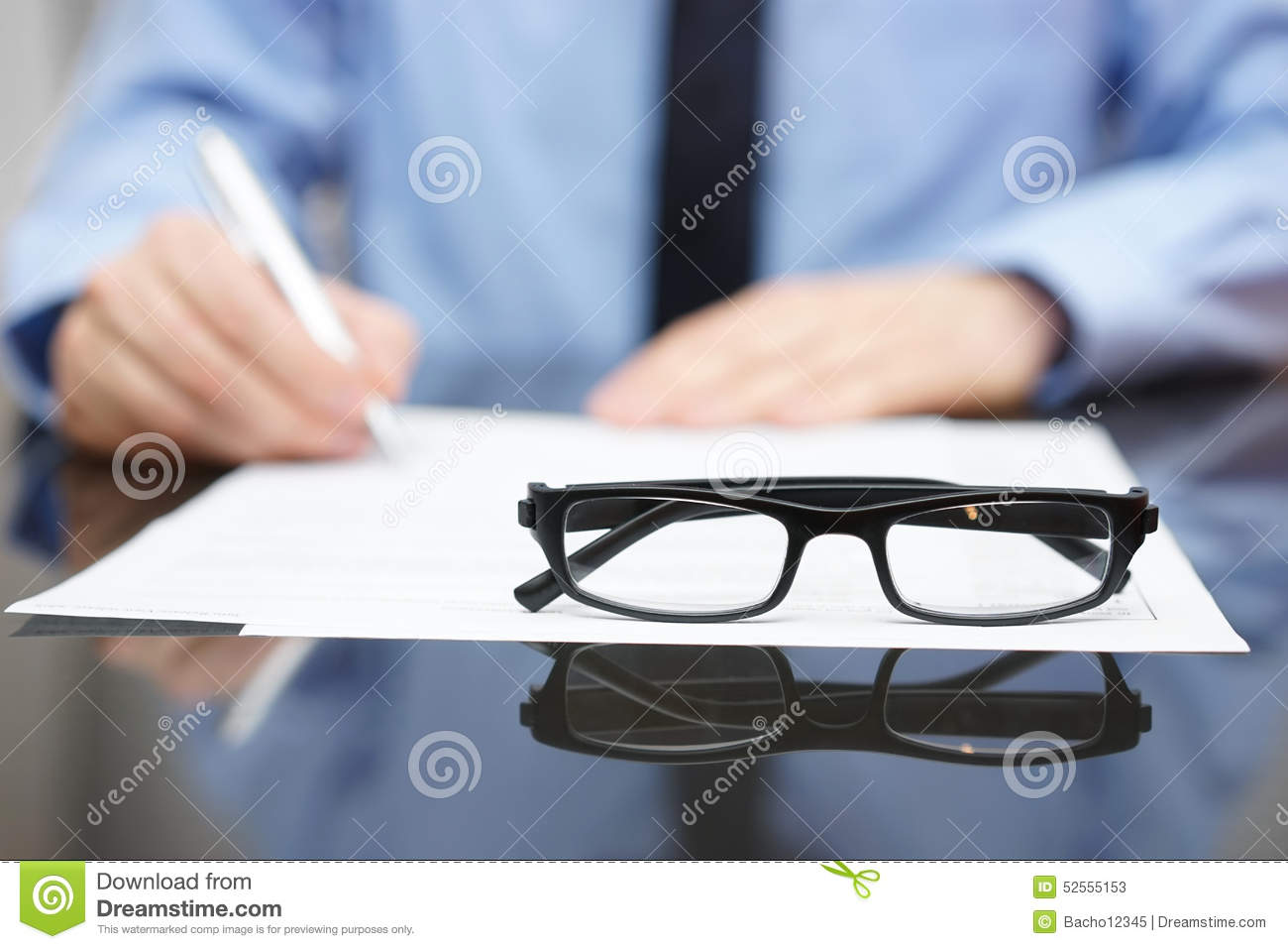 Blurred busy entrepreneur in background with focus on glasses