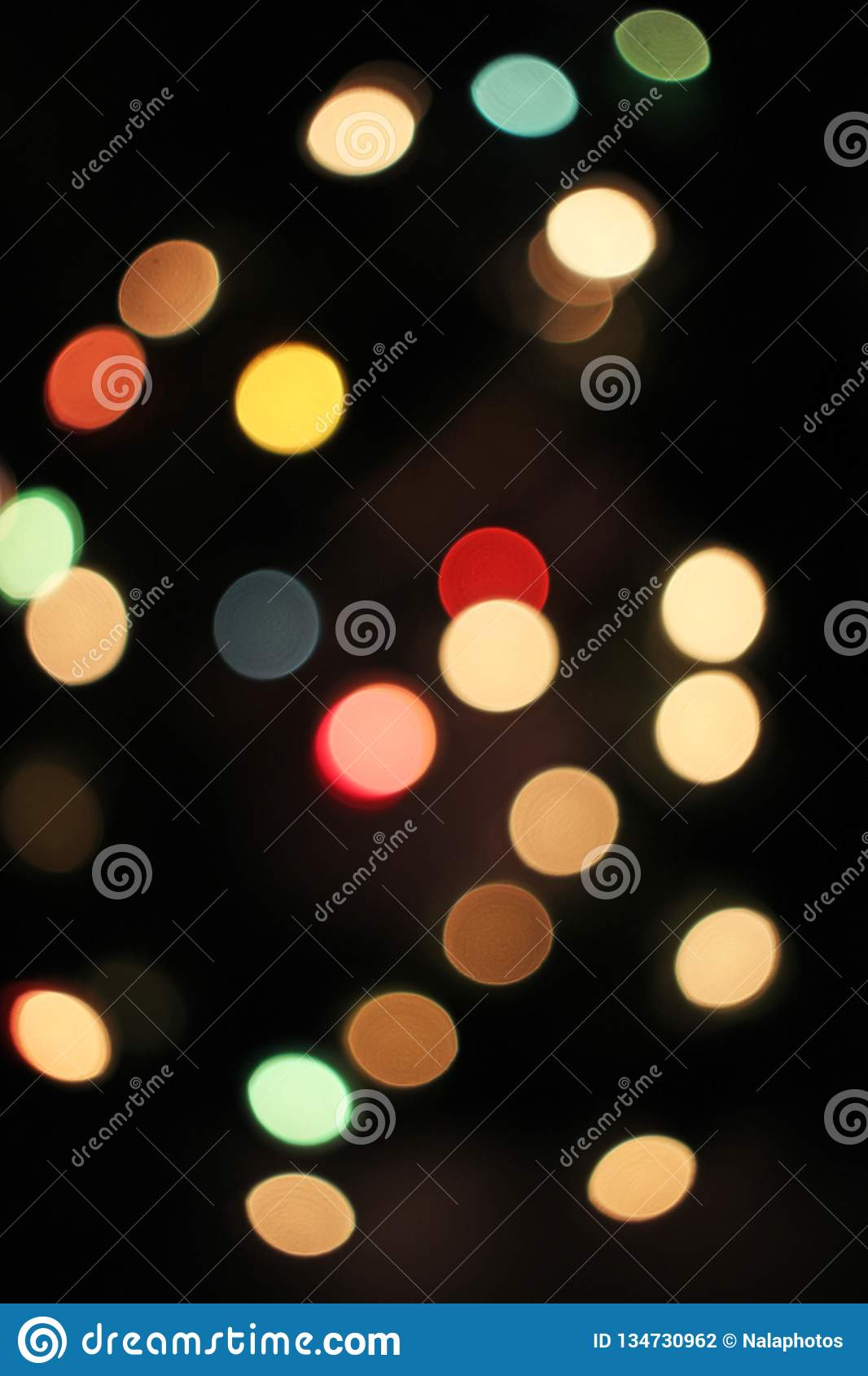 Blurred defocused christmas light lights bokeh background. Colorful red yellow blue green de focused glittering pattern