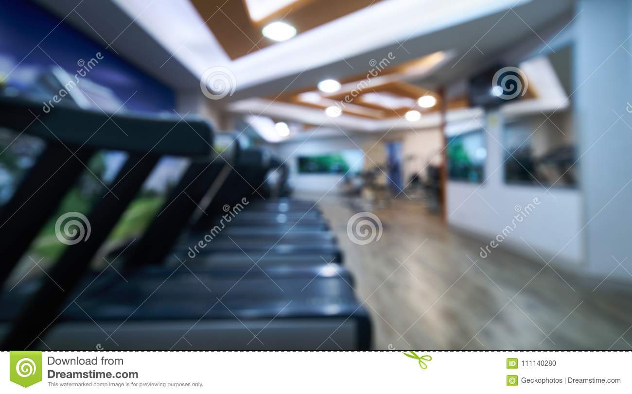 Blurred of fitness gym room background stock photo image of club