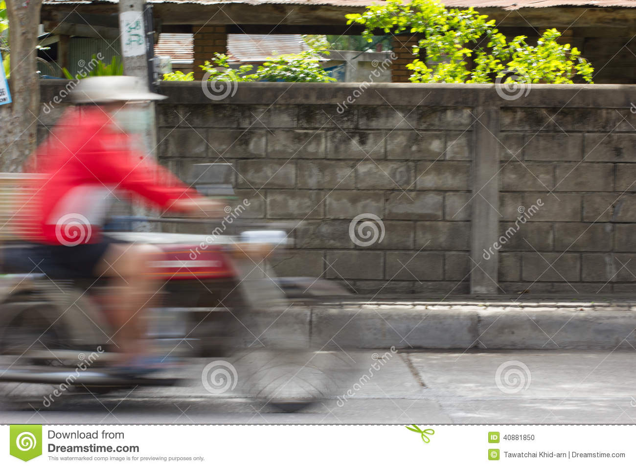 Blurred image of vehicles running on street in Thailand (motion