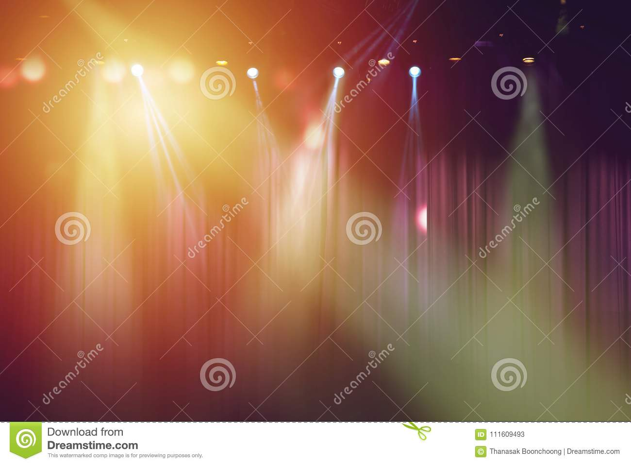 Blurred lights on stage and red curtain theatre