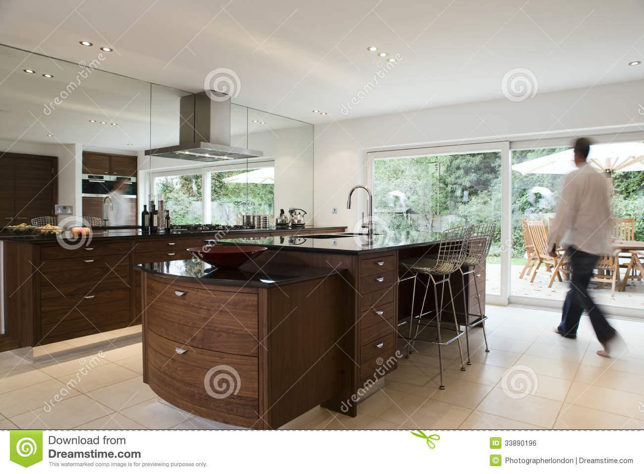 Blurred Man In Modern Kitchen Royalty Free Stock Image