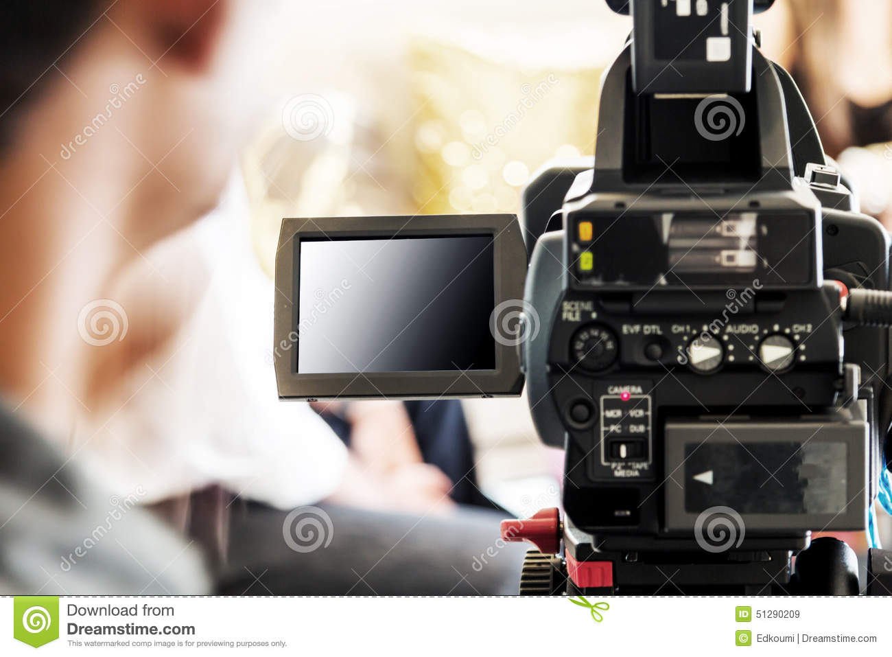 blurred man with video camera stock photo