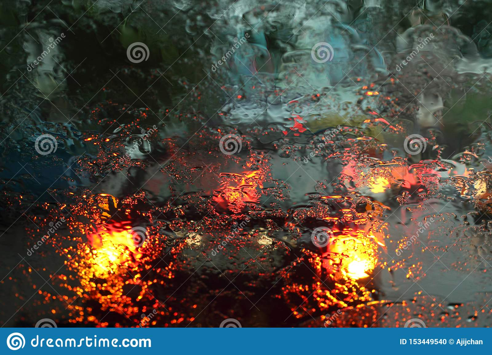 Vehicles viewed through a wet glass in the rain