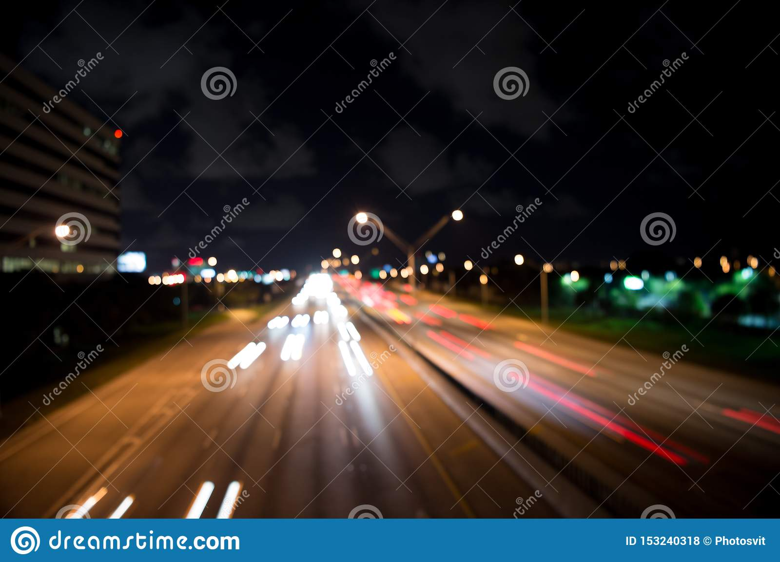 Blurred night city lights. defocused speed background. blur night life. illumination. Abstract urban night light