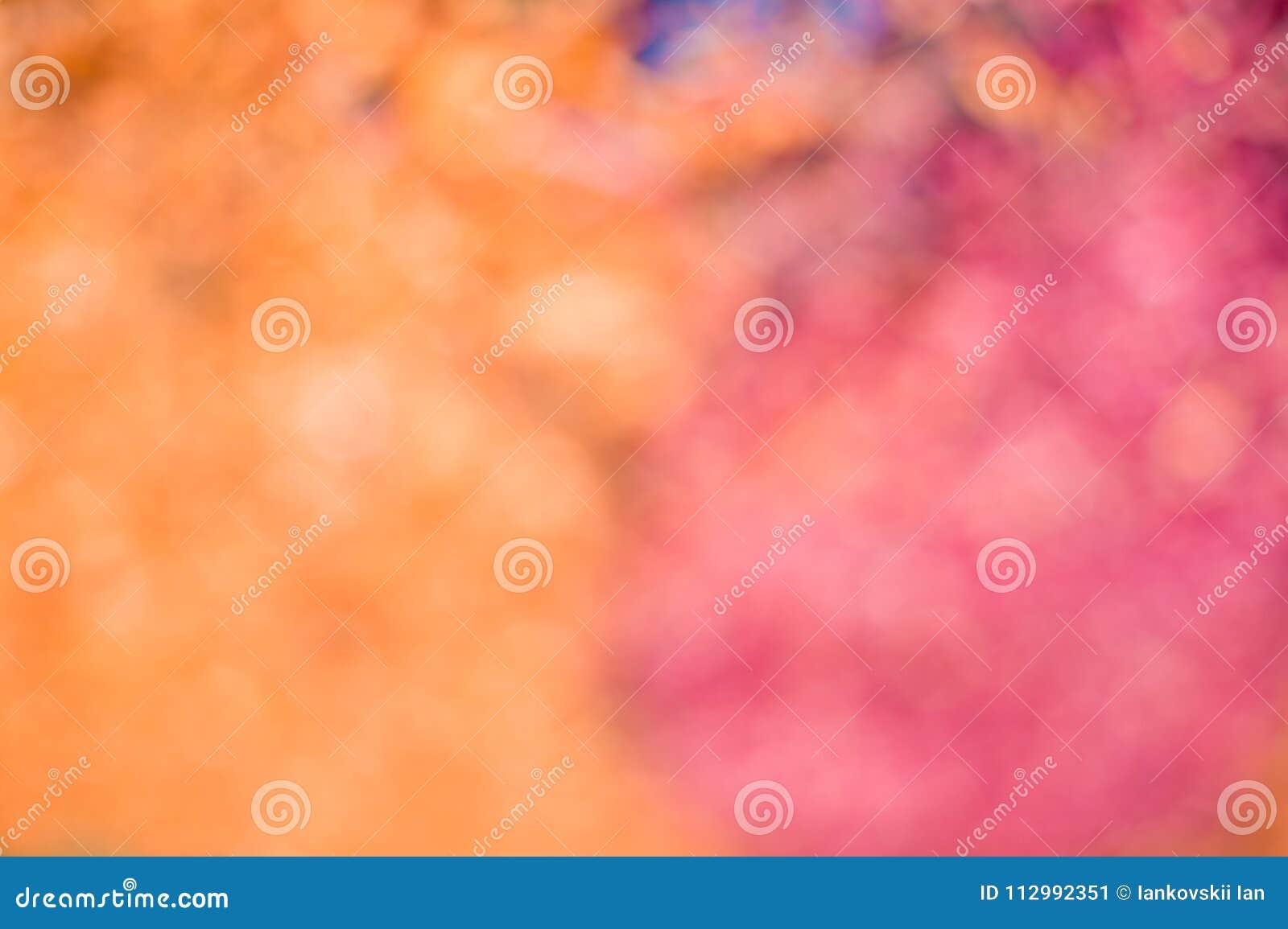 Blurred orange-red background. Orange-red sawdust in defocus