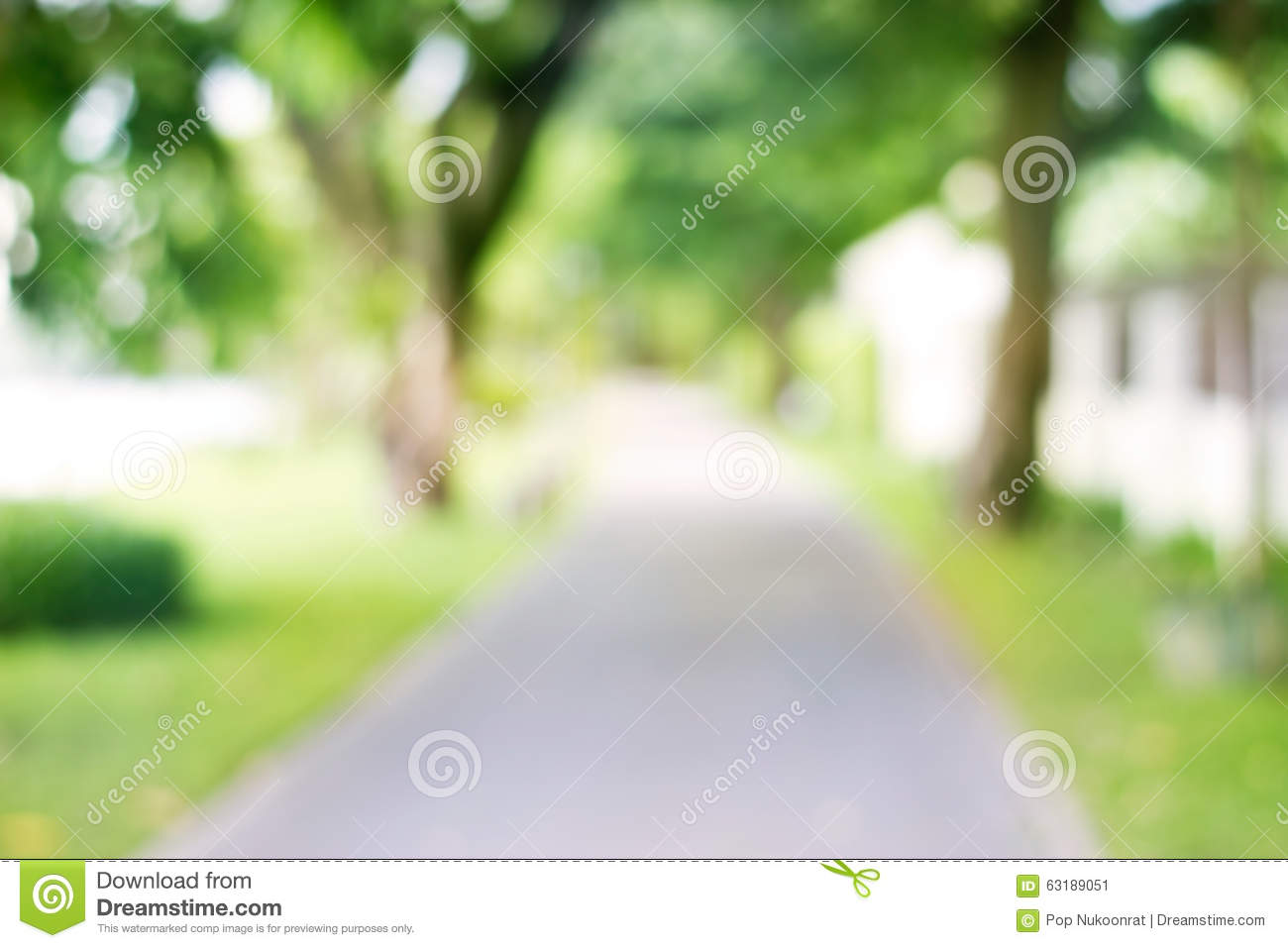 Blurred Park With Side Walk On Green Nature Background Stock Image