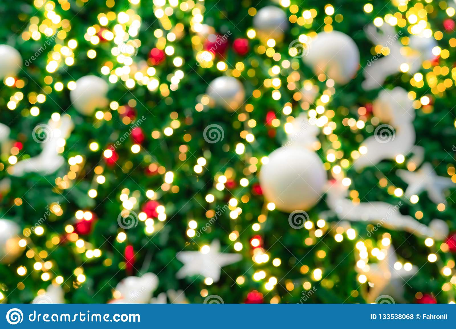 blurred red green and gold bokeh background of christmas tree xmas background