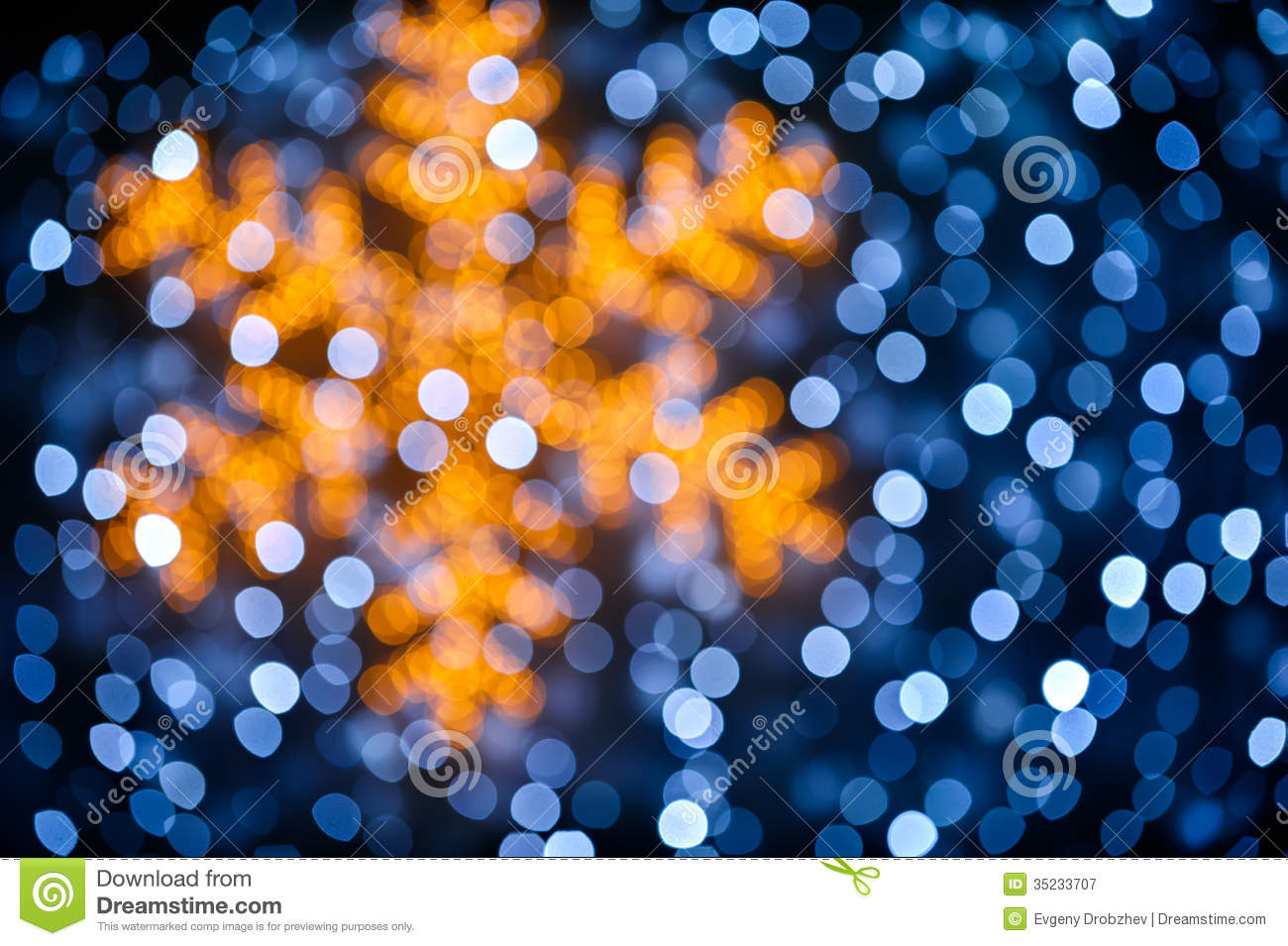 Silver and golden background of defocused abstract lights bokeh - Blurred Snowflake And Lights Background Royalty Free Stock