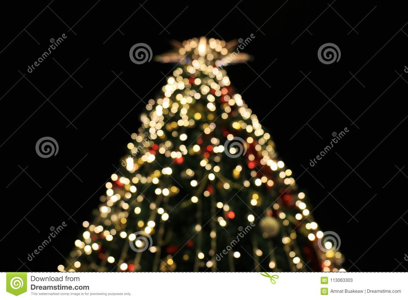 blurred christmas tree decoration background with night lights christmas holiday celebration christmas trees