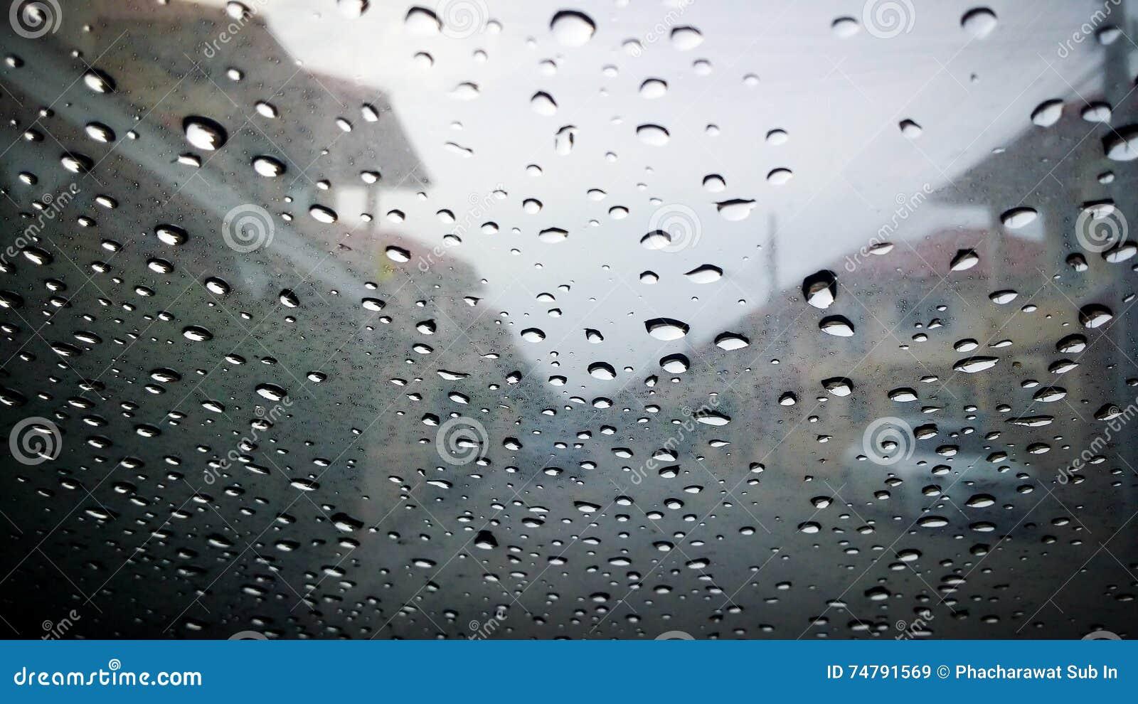 the blurred of water rain drop on car window