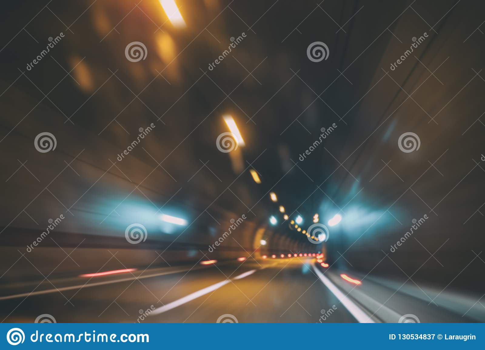 Blurry car tunnel with lights, motion blur background