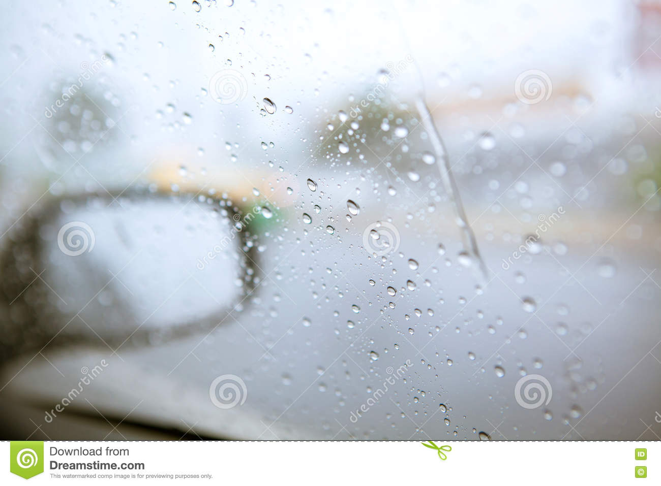 Blurry Drop Of Rain On Car Side Mirror On The Road With
