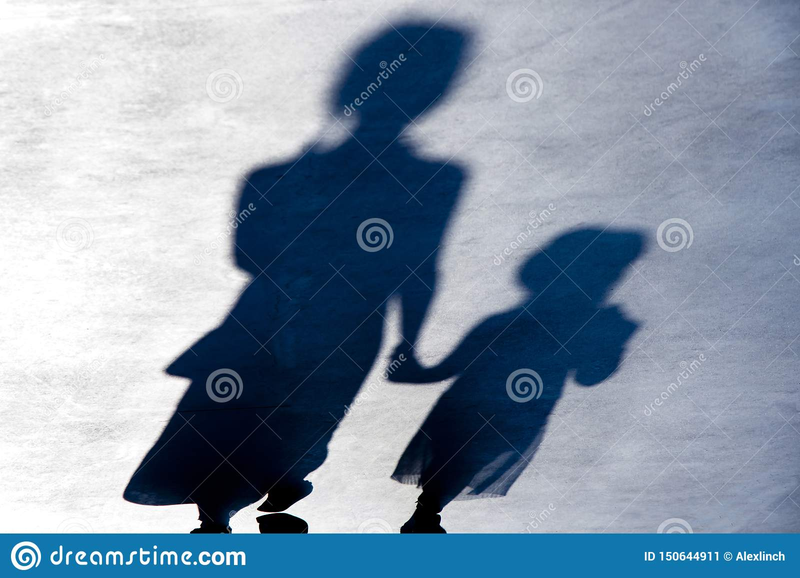 Blurry vintage shadows silhouettes of two person walking in the night