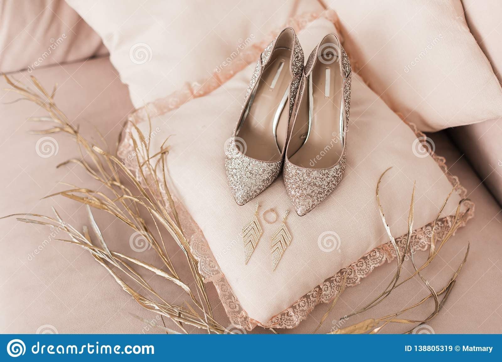 82870015b677 Blush pink bridal shoes and accenting jewelry and perfume with gold floral  decoration. Pink background. Close up and top view.