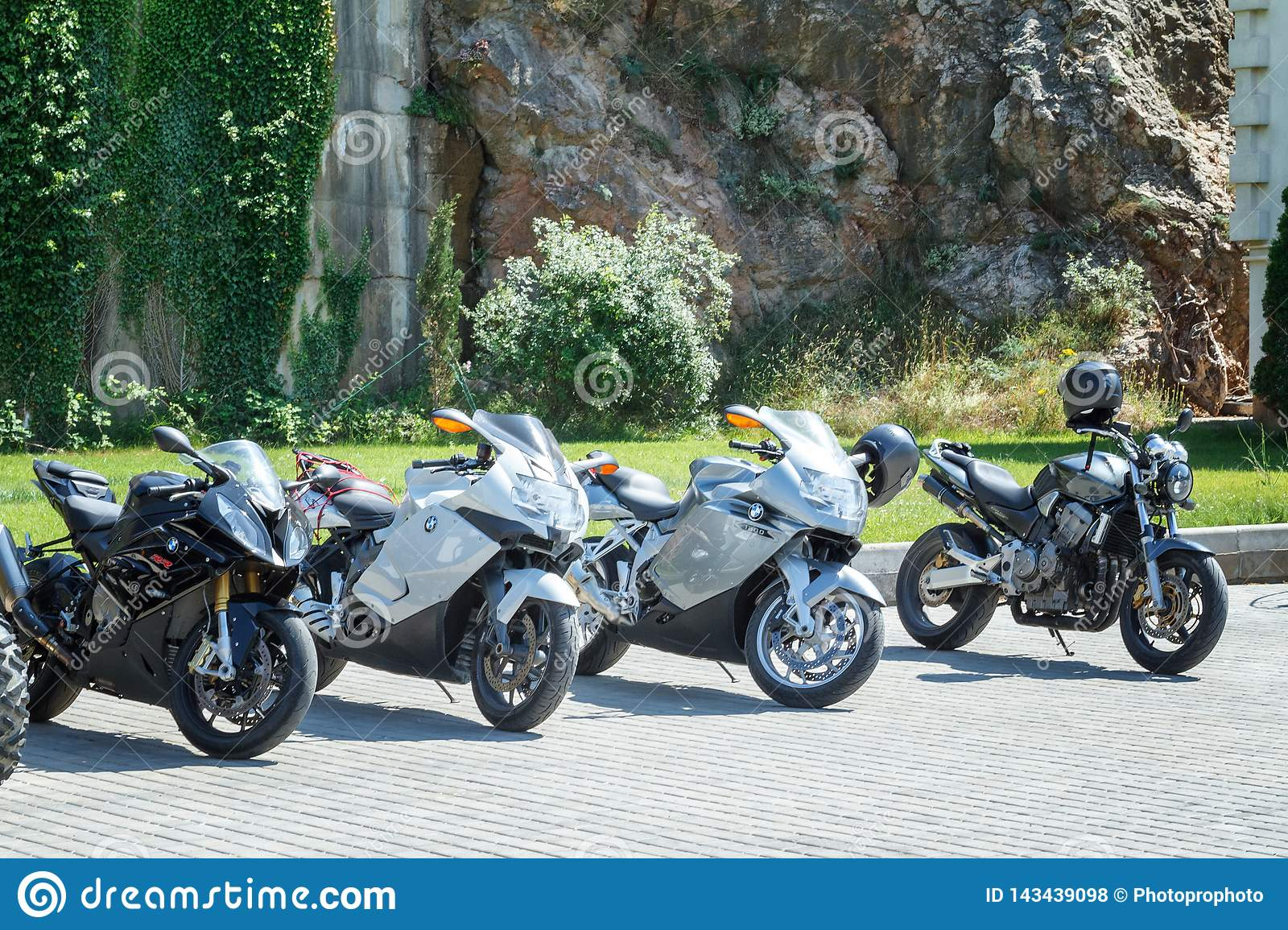 BMW motorcycles are on the waterfront against the rock, July 9, 2018 embankment in Balaklava