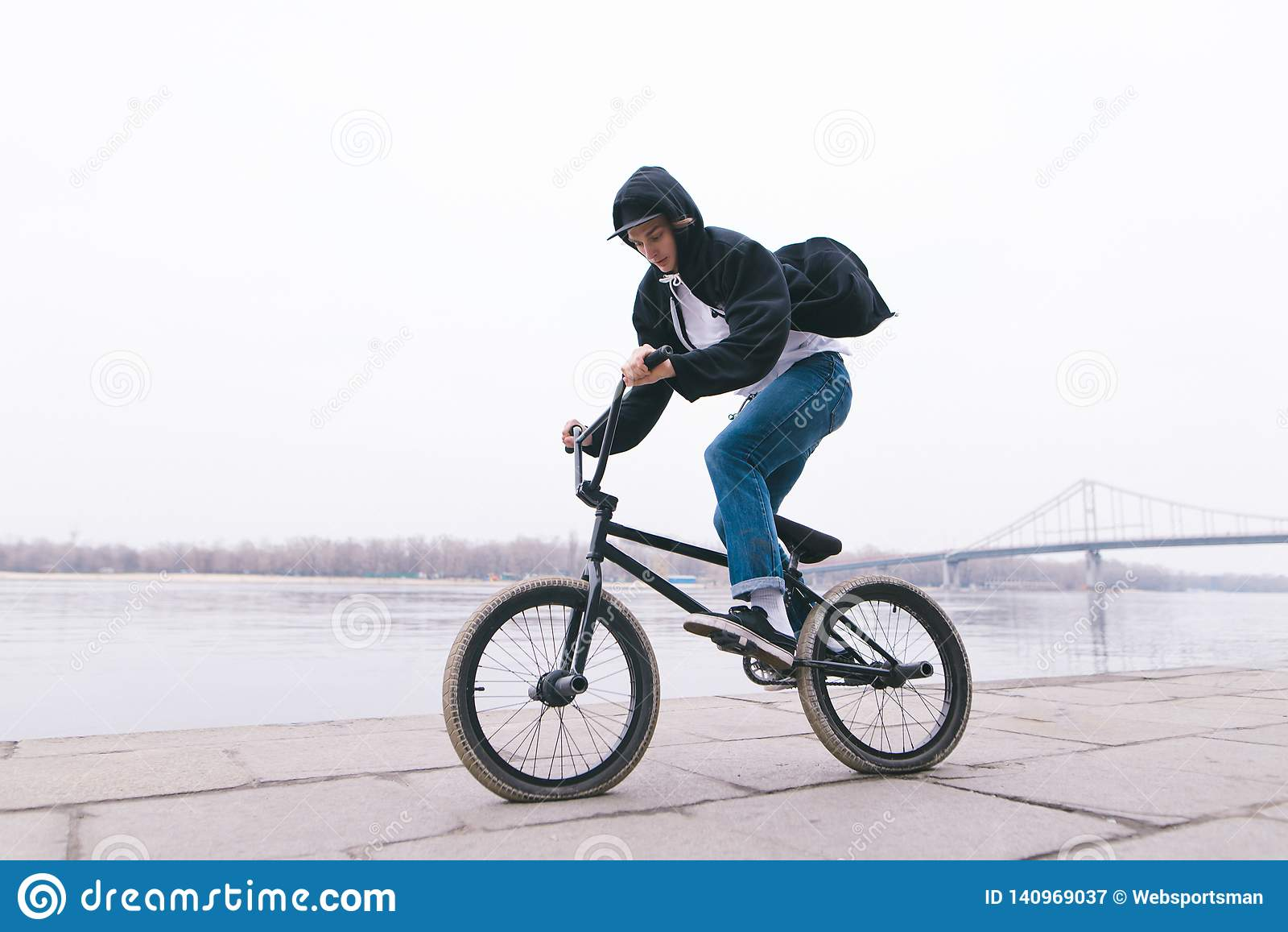 BMX rider rides a bike in the open air. BMX concept. Street style