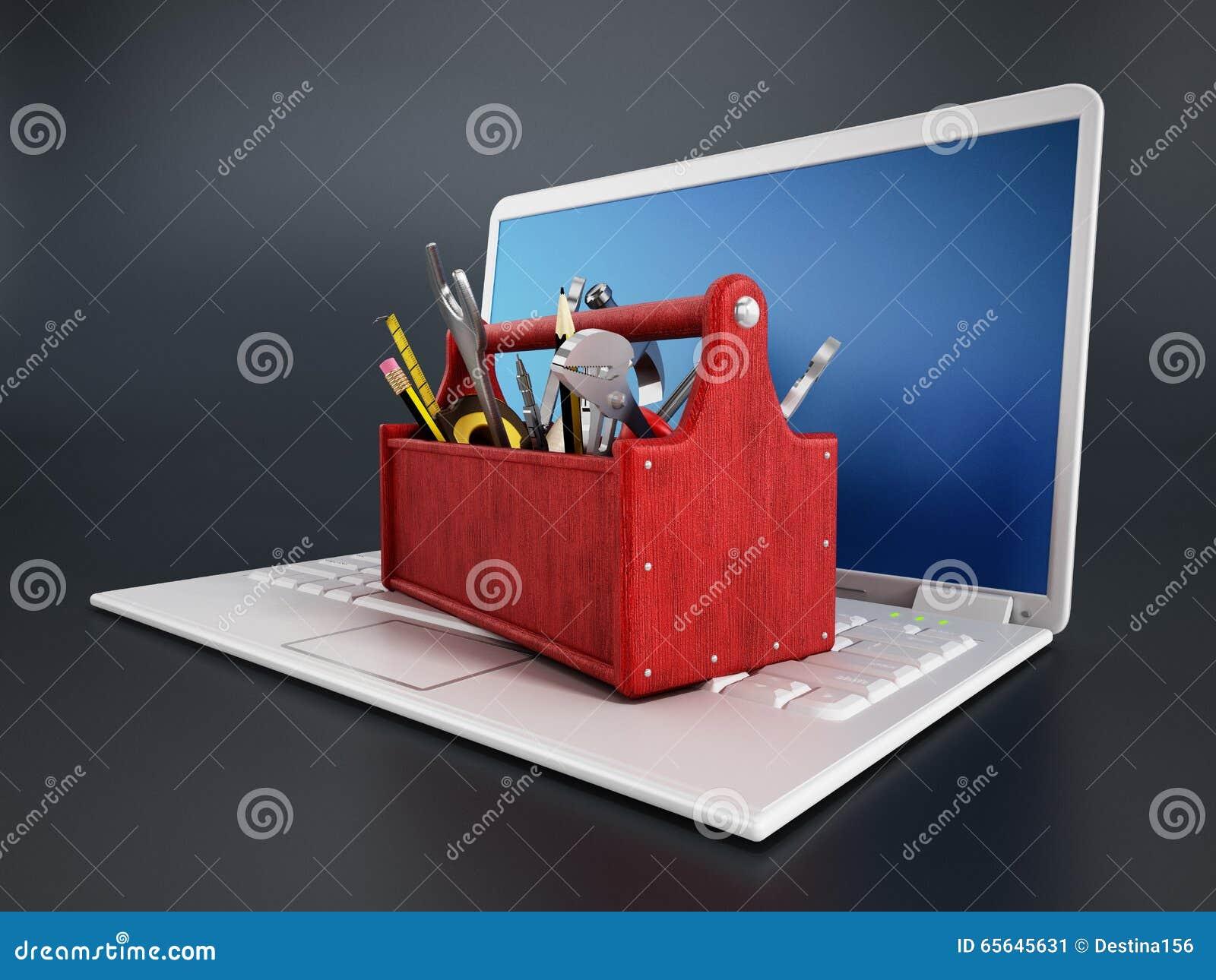 Boîte à outils rouge se tenant sur l ordinateur portable