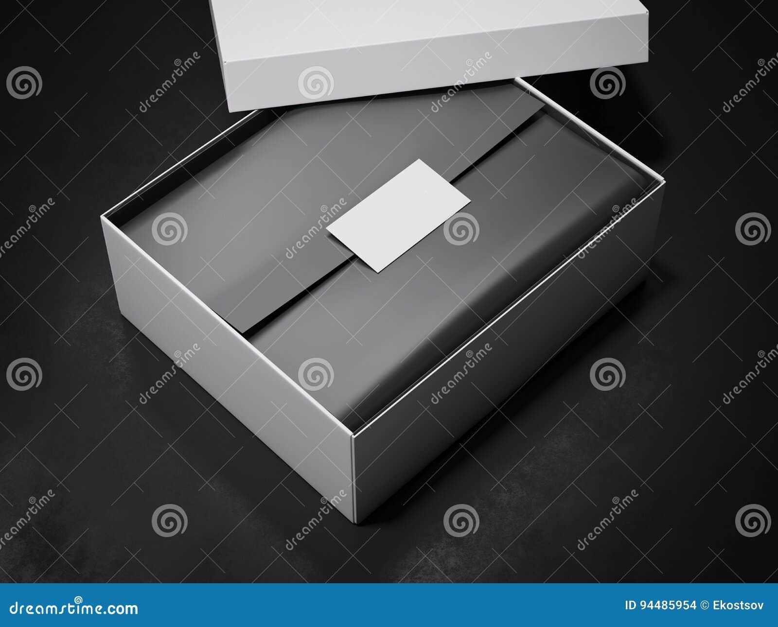 Botier Blanc Avec Le Papier D Emballage Et La Carte De Visite Professionnelle Noirs
