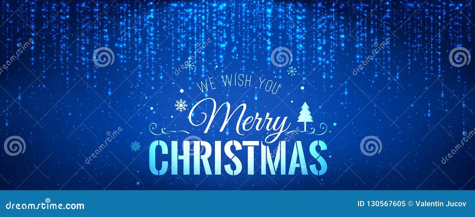 Boże Narodzenia i nowy rok typographical na błękitnym tle z iskrzyć, światło, grają główna rolę Rozjarzonej błyskotliwości lekcy