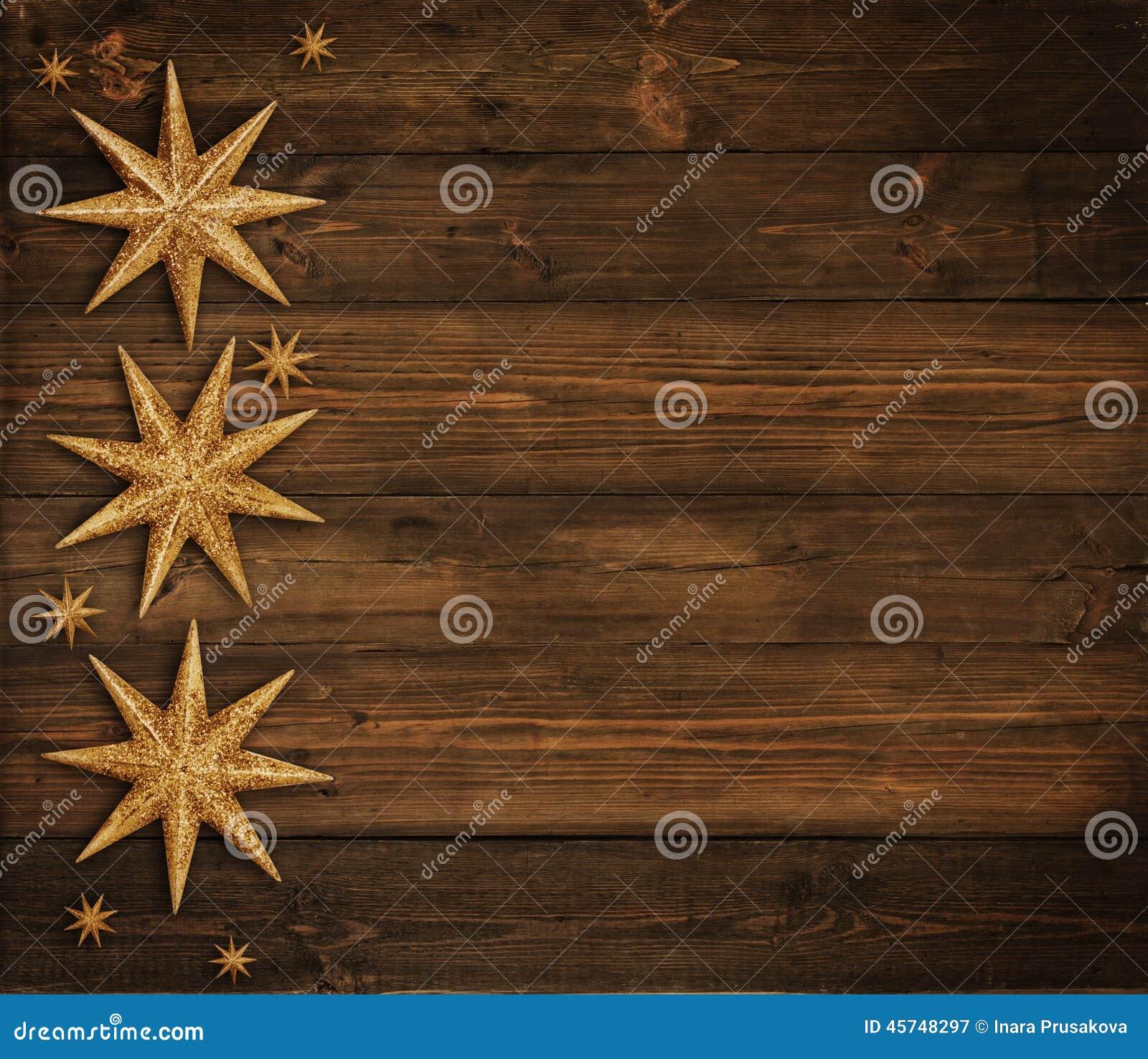 Bożenarodzeniowy Drewniany tło, Złota gwiazdy dekoracja, Brown drewno