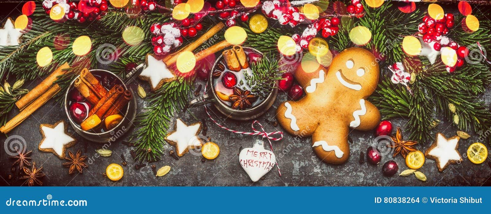 Bożenarodzeniowy sztandar z Piernikowym mężczyzna, ciastka, rozmyślał wino, wakacyjne dekoracje, jodeł gałąź i świątecznego bokeh