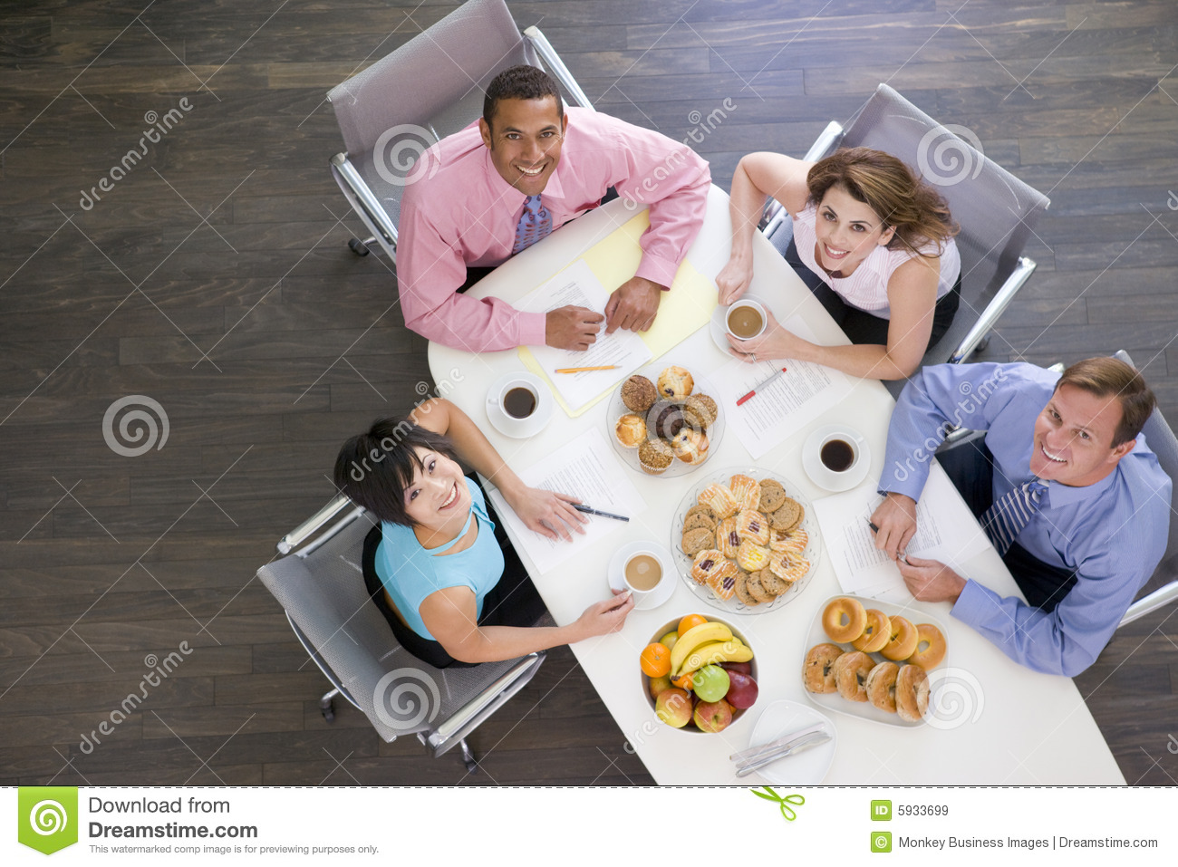Boardroom businesspeople eating four table