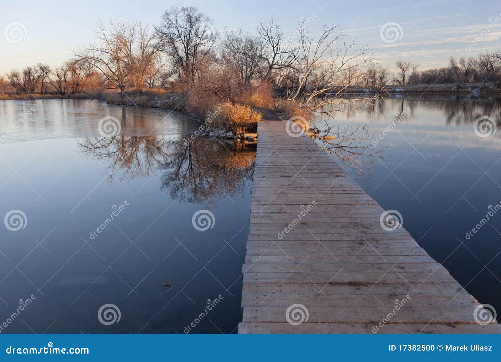 Boardwalk pathway over lake