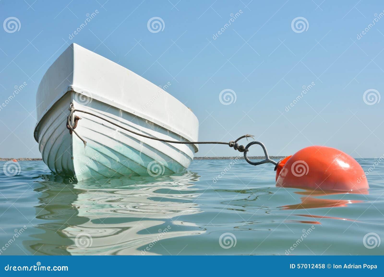 Boat Anchored Floating Stock Photo - Image: 57012458