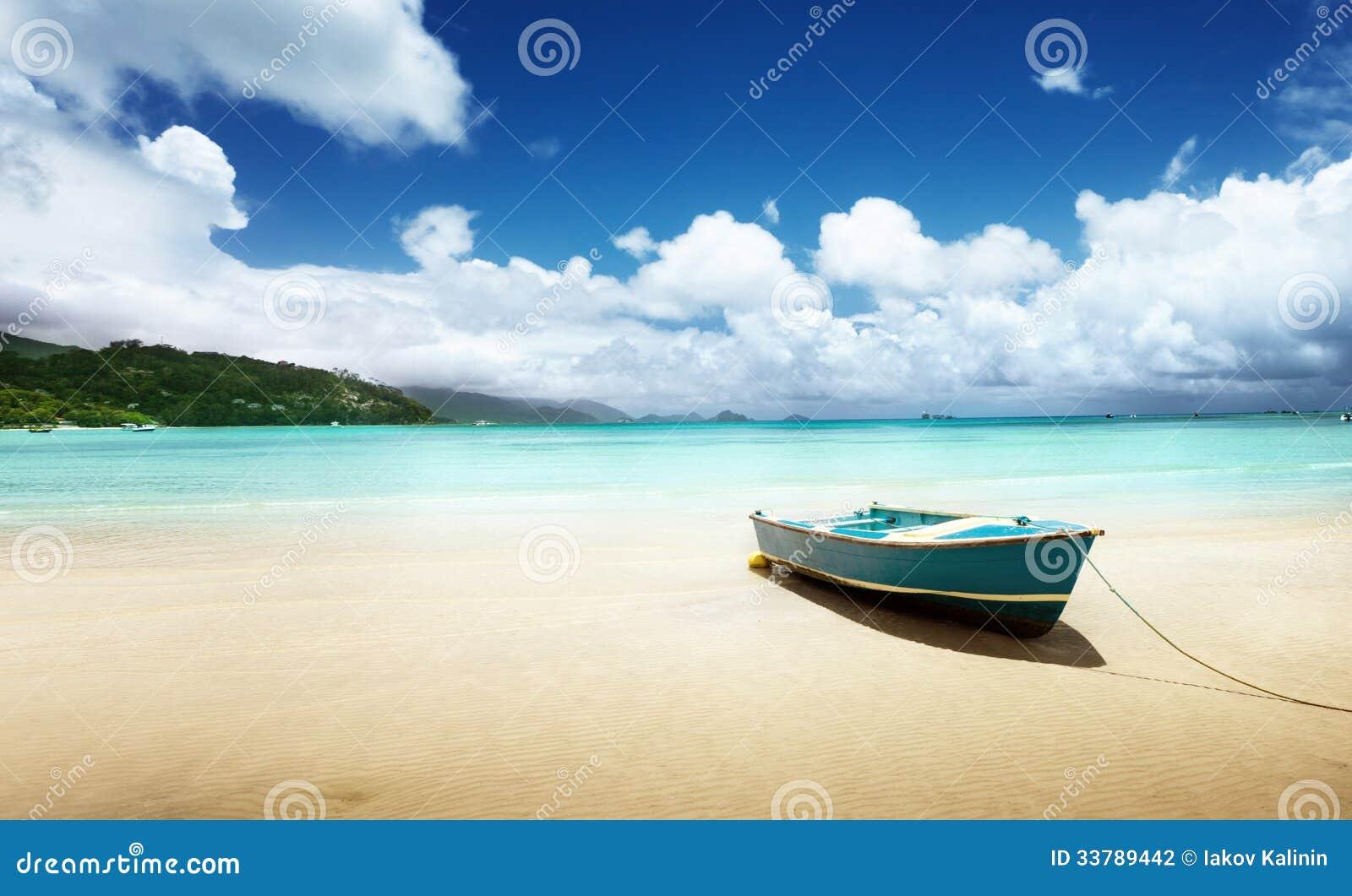 Boat on beach Mahe island stock photo. Image of coconut ...