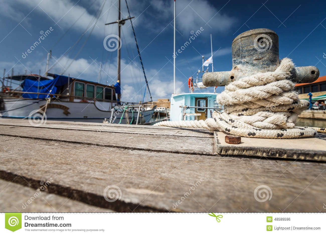 Boat docking point at a marina - rope fixed around a belay