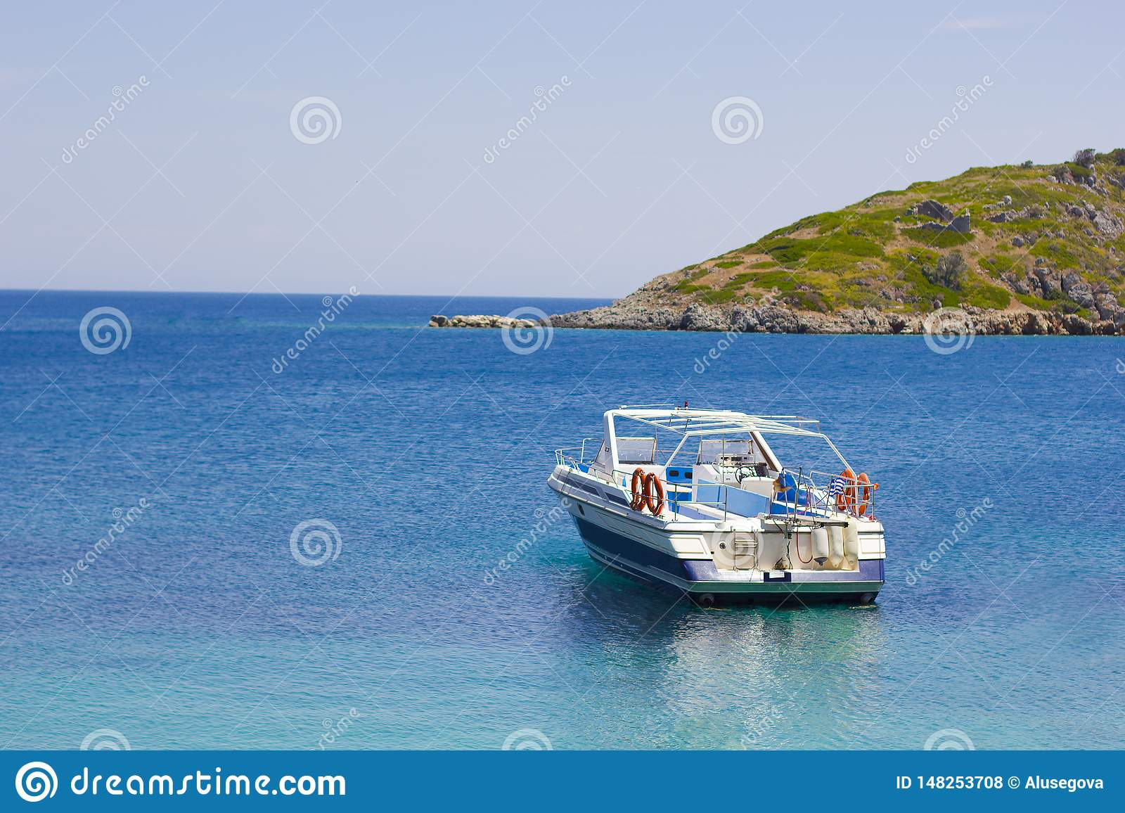 Boat in blue sea on a coastline