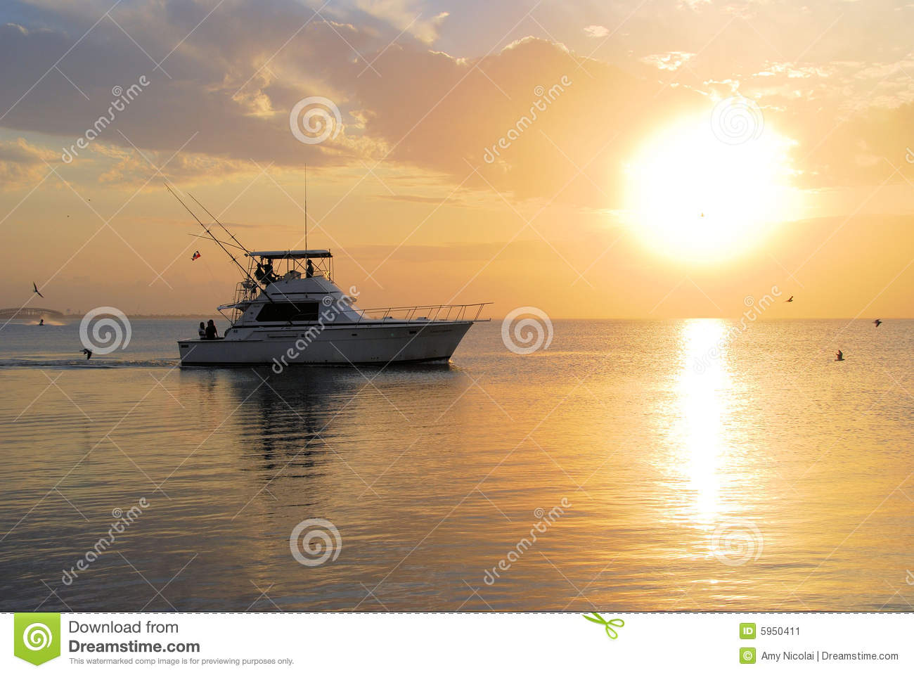 Boat going fishing at sunset