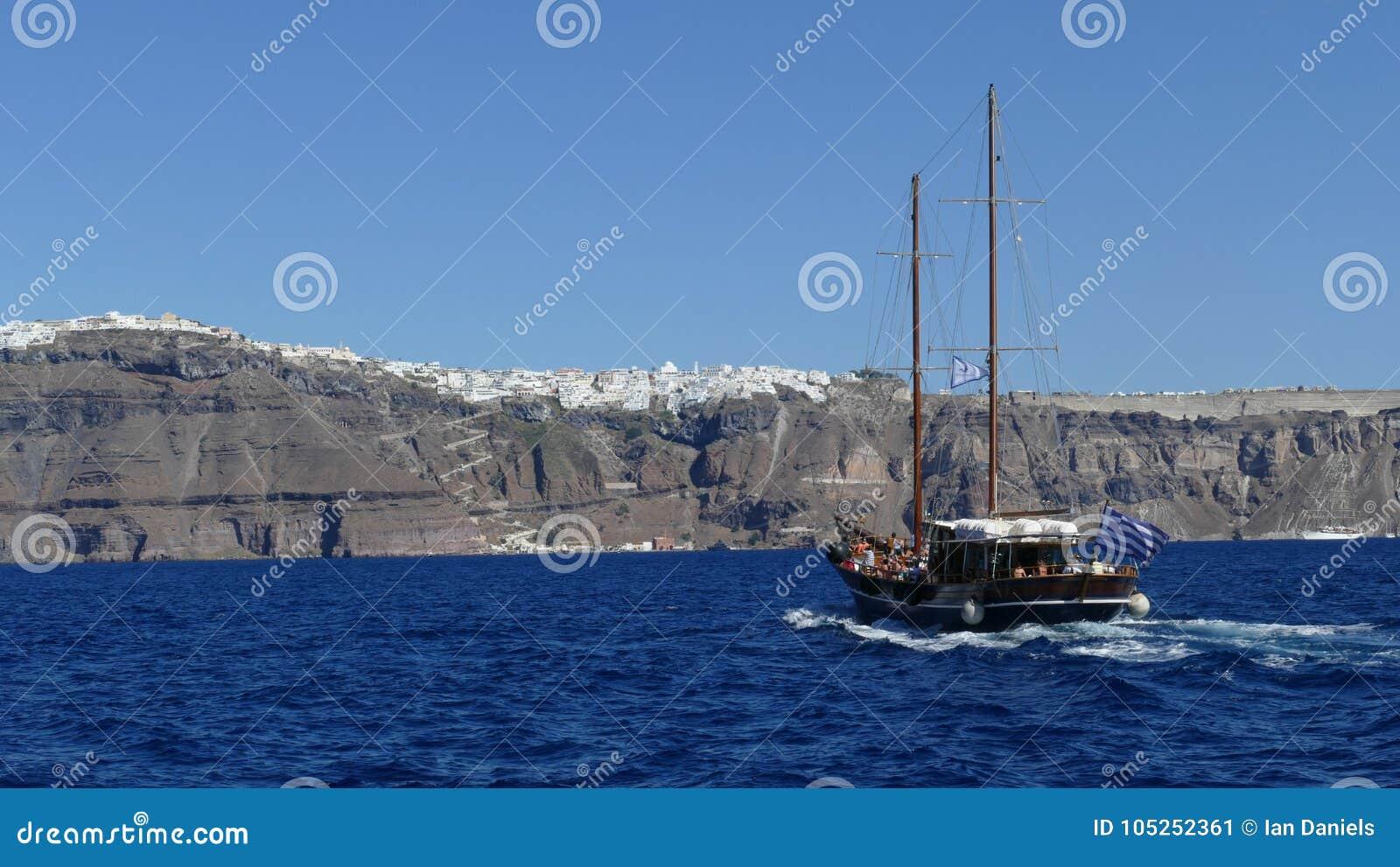 Boat heading towards the town of Fira in Santorini