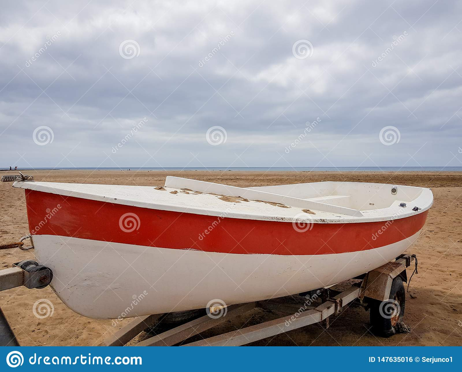 A Boat On Land With White And Red Paint Colors And On Its Extraction Trolley Stock Photo Image Of Fish Outdoor 147635016
