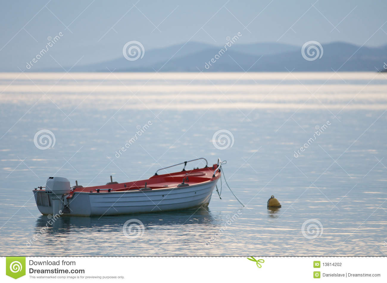 Boat moored on calm sea stock photo. Image of motor, outboard - 13814202