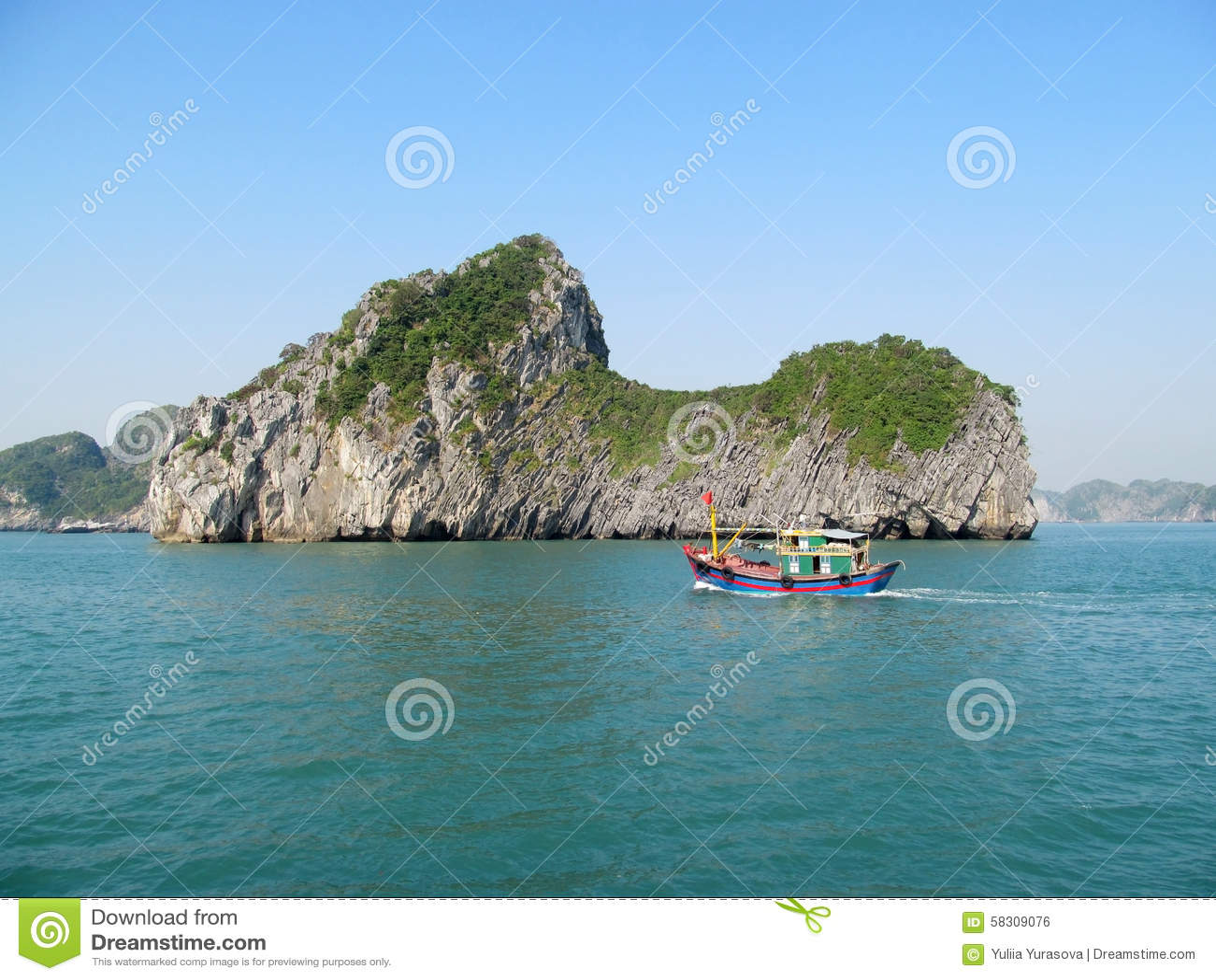 Boat passing scenic islands in the sea