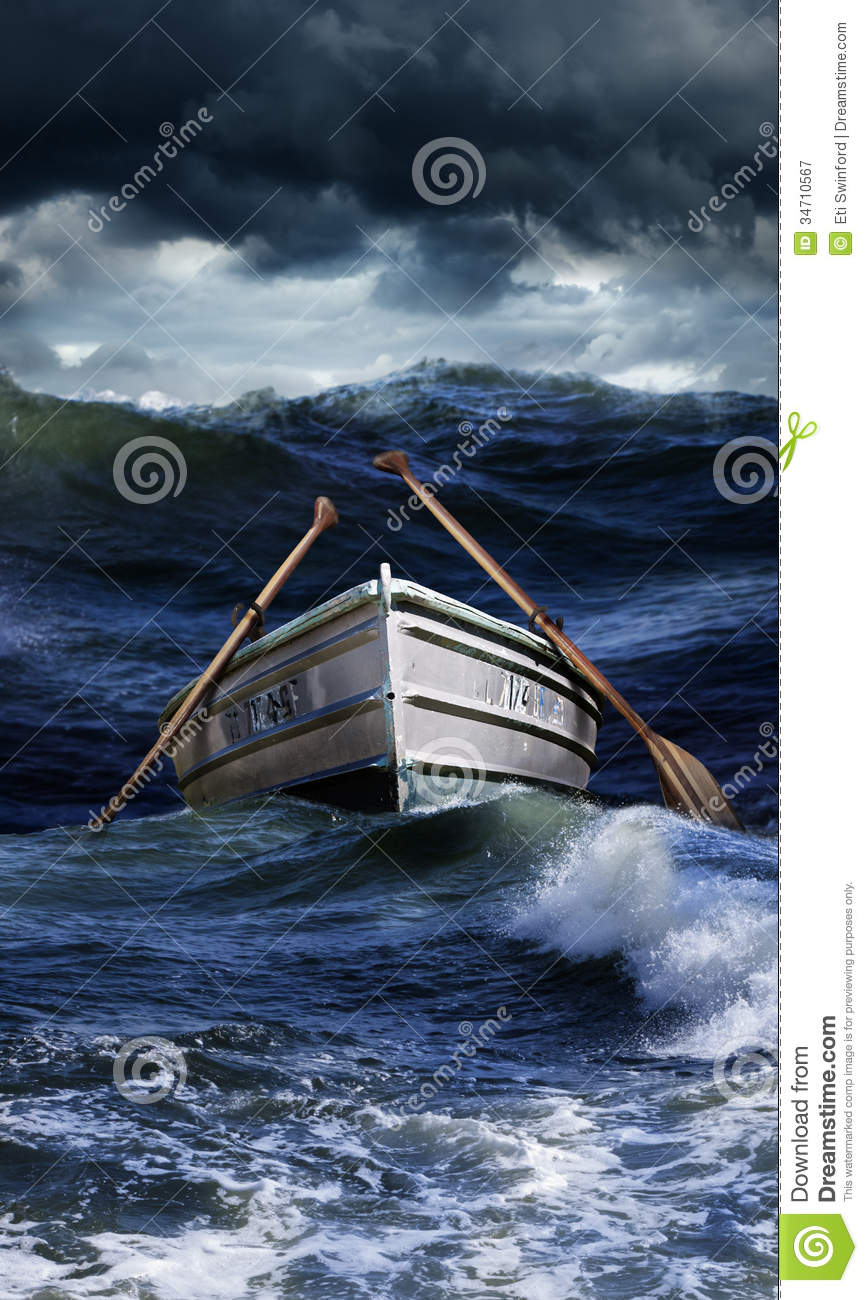 row boat abandoned in a rough ocean or sea with oars. Concept for ...