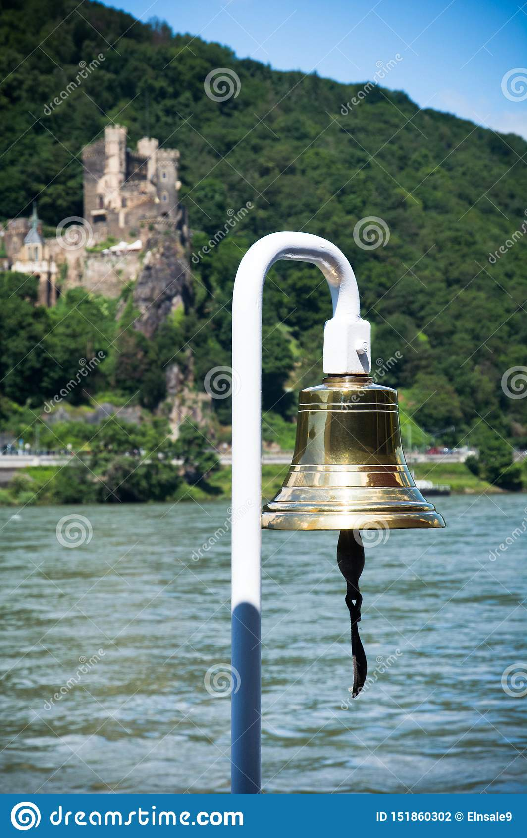 Boat`s bell on a river with a castle in the background