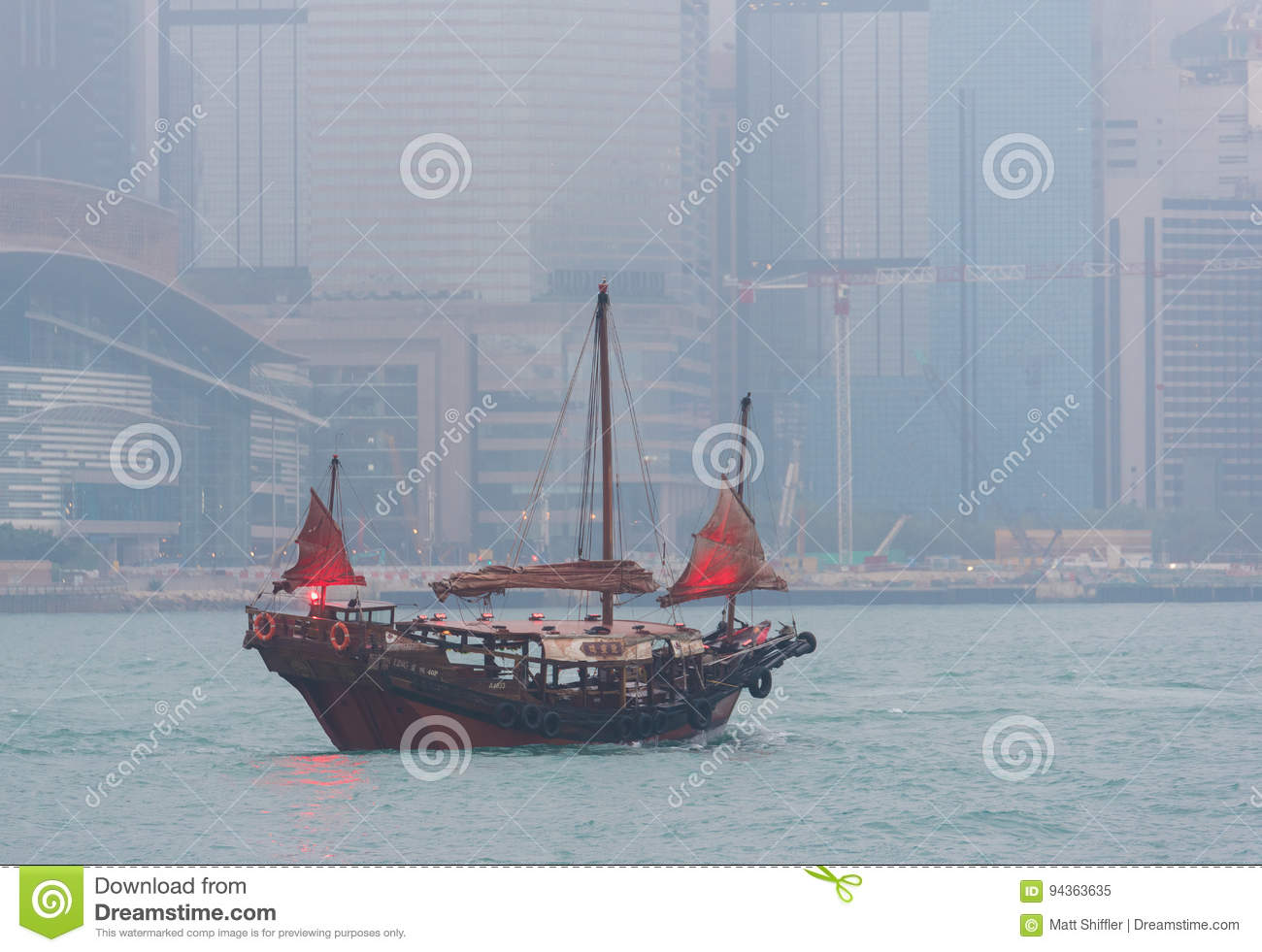 A Boat Sails In Victoria Harbor In Hong Kong Editorial Image