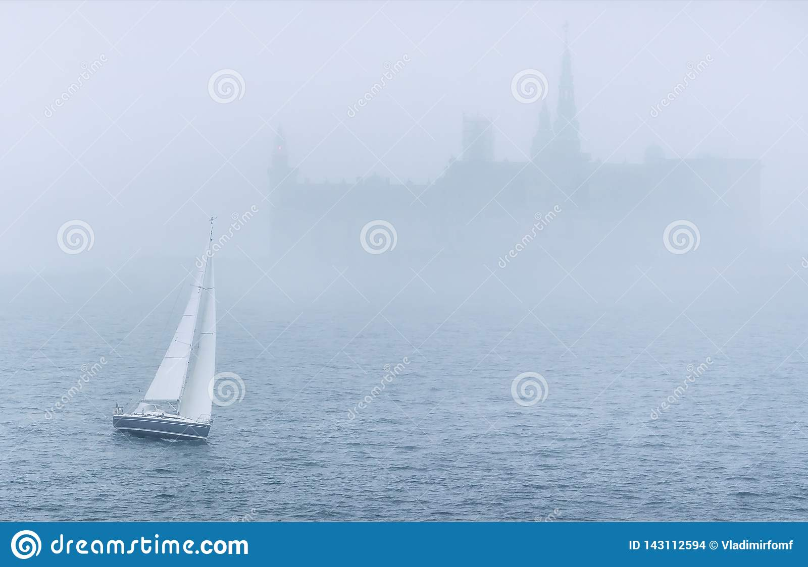 Boat in the sea in mist