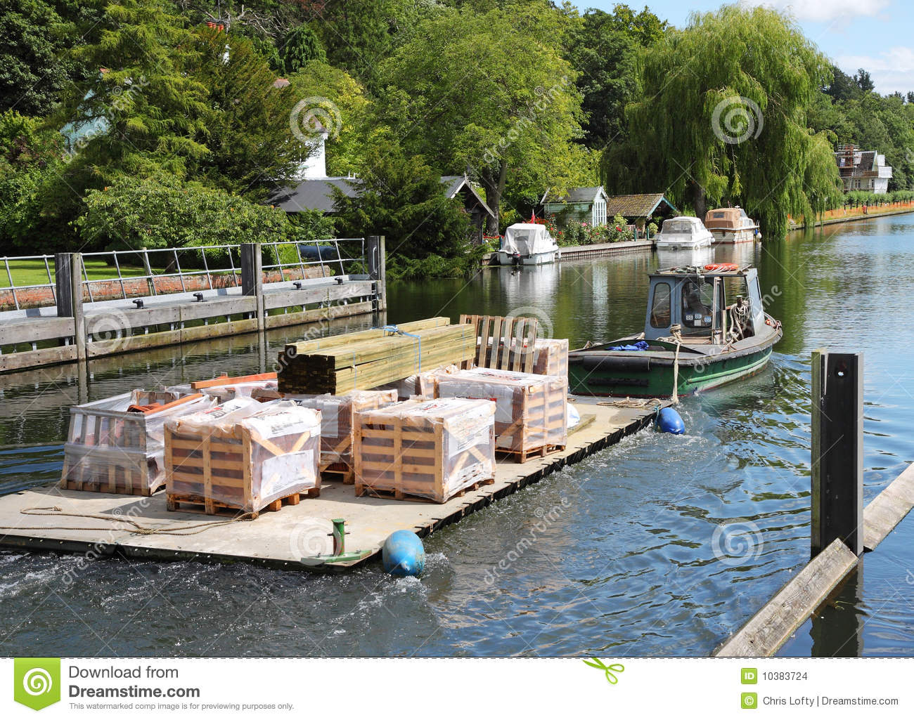 Boat Towing Supplies Along A River Stock Photo - Image of
