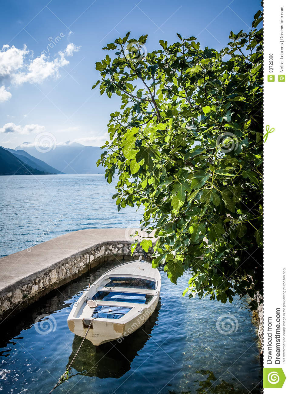 Boat in the water garage stock photo. Image of warm ...