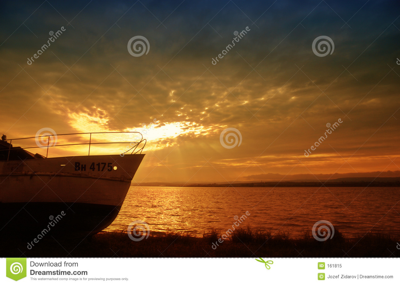 Boat on water with sunset