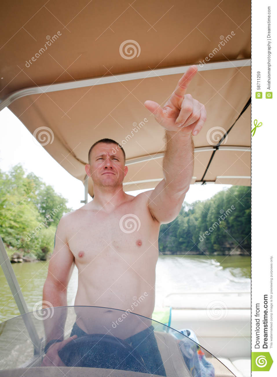 Boater: Man Driving a Boat Pointing