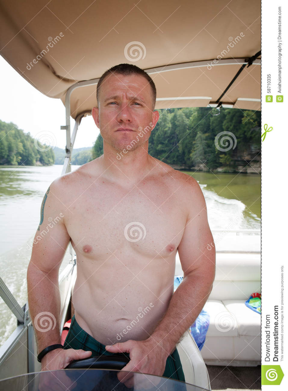 Boater: Man Driving a Boat